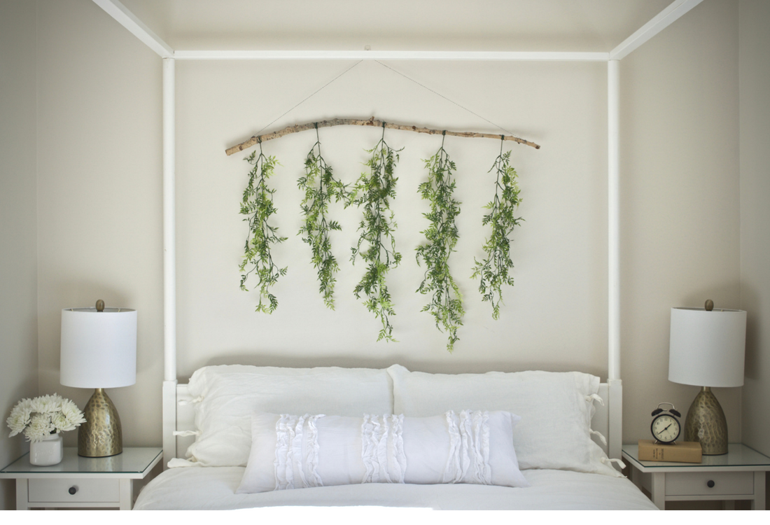white grey master bedroom hanging greens greenery Calgary staging decorating interior designer stager airy bright bedding four post bed
