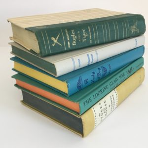 vintage book stack decor blue green yellow orange