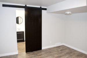 barn door bathroom bedroom sliding door black and white benjamin moore revere pewter vinyl flooring