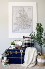 blue trunk decor styled styling ideas bench vintage tray books plants basket plaid pillow Calgary antique map giant map art