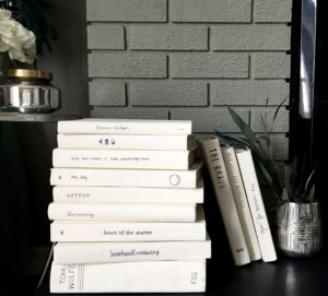 stack of vintage white books painted hardcover hearth fireplace decor bedroom white cream chalk paint greens neutral decor DIY