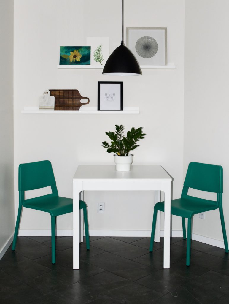 "small dining nook breakfast nook kitchen awkward corner green chairs teal white herringbone tile grey gray 12x24"" inches 1x2' feet photo ledges black pendant light eat in kitchen styled shelf"