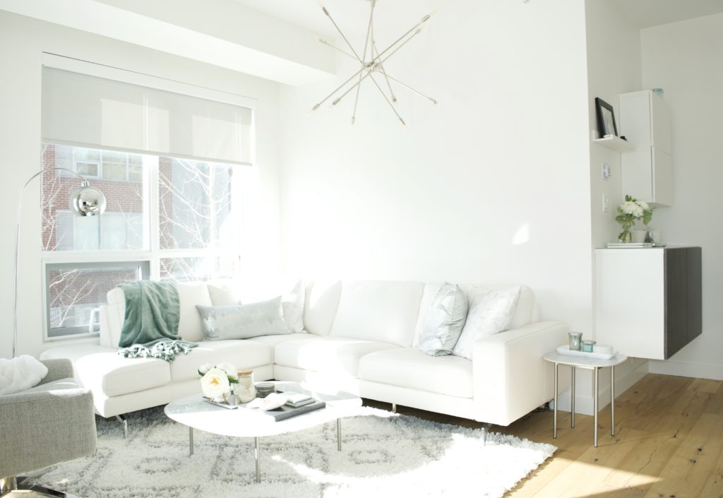 modern scandinavian scandi glam white grey black ivory concrete pillar design swivel chair sectional silver decor living room apartment small space marble table white leather sectional seafoam green pastel soft bright white paint calgary interior designer home by freya maclean
